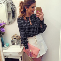 Elegante blusa de manga comprida