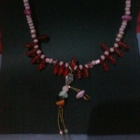 colar boneca delicada